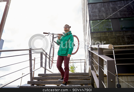 young hipster man carrying fixed gear bike in city stock photo, people, sport, style, leisure and lifestyle - young hipster man carrying fixed gear bike on shoulder down stairs in city by Syda Productions
