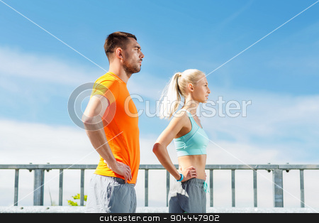sporty couple outdoors stock photo, fitness, sport, friendship and healthy lifestyle concept - sporty couple outdoors by Syda Productions
