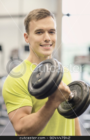 smiling man with dumbbell in gym stock photo, sport, fitness, lifestyle and people concept - smiling man with dumbbell in gym by Syda Productions