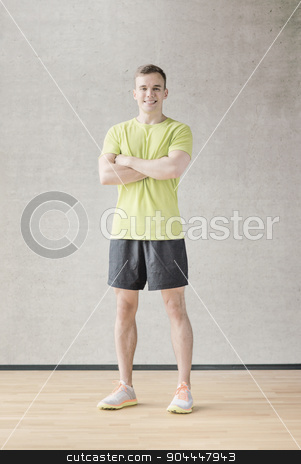 smiling man in gym stock photo, sport, fitness, lifestyle and people concept - smiling man in gym by Syda Productions