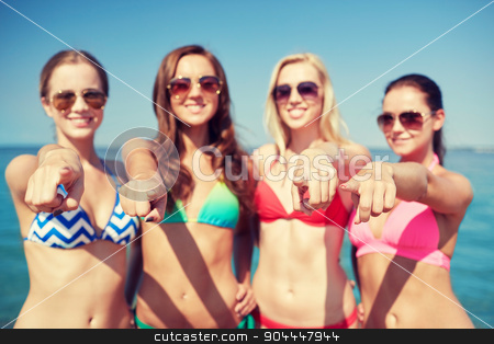 group of happy women pointing at you on beach stock photo, summer vacation, holidays, travel, gesture and people concept - group of happy young women pointing finger on you on beach by Syda Productions