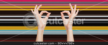 woman hands showing ok sign over blue sky stock photo, gesture, people and body parts concept - woman hands showing ok sign over blue sky and clouds background by Syda Productions