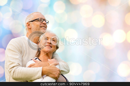 happy senior couple over holidays lights stock photo, family, age, love, relations and people concept - happy senior couple over holidays lights background by Syda Productions