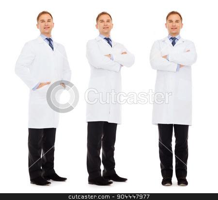 happy doctors in white coat stock photo, medicine, science, profession and health care concept - happy doctors in white coat by Syda Productions