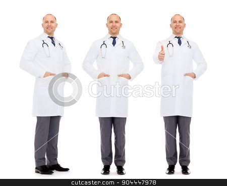 happy doctors with stethoscope showing thumbs up stock photo, medicine, profession and health care concept - happy doctors with stethoscope showing thumbs up by Syda Productions