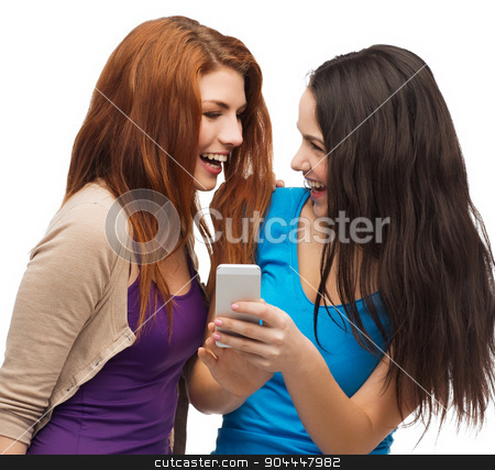 two smiling teenagers with smartphone stock photo, technology, friendship and people concept - two smiling teenagers with smartphone by Syda Productions