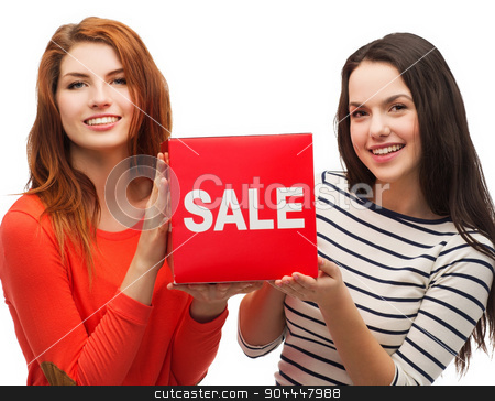 two smiling teenage girl with percent sign on box stock photo, shopping, sale, and gift sconcept - two smiling teenage girls with sale sign on red box by Syda Productions