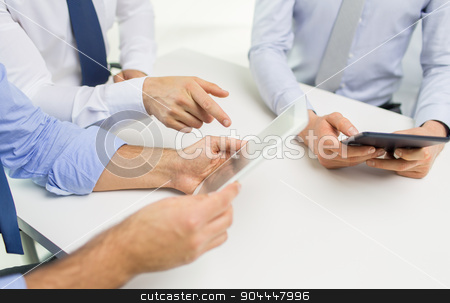 close up of businessman hands with tablet pc stock photo, business, people, technology and teamwork concept - close up of businessman hands with tablet pc computer at office by Syda Productions