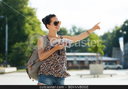 happy teenage girl with guidebook and backpack stock photo, tourism, travel, summer holidays and people concept - happy teenage girl with guidebook and backpack in city by Syda Productions