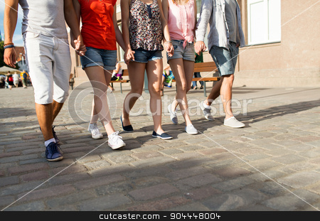 close up of teenage friends walking in city stock photo, friendship, travel, tourism, summer vacation and people concept - close up of teenage friends walking in city by Syda Productions
