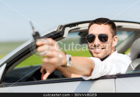 happy man in cabriolet showing car key stock photo, auto business, transport, leisure and people concept - happy man in cabriolet showing car key by Syda Productions