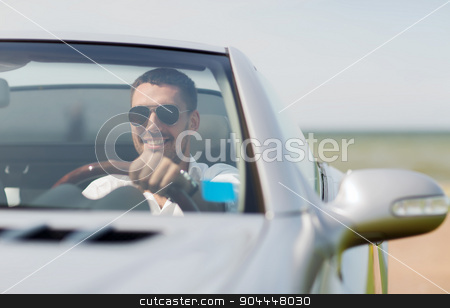 happy man driving cabriolet car outdoors stock photo, auto business, transport, leisure and people concept - happy man driving cabriolet car outdoors by Syda Productions