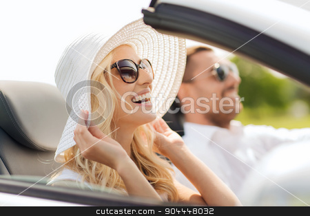happy man and woman driving in cabriolet car stock photo, transport, leisure, road trip and people concept - happy man and woman driving in cabriolet car outdoors by Syda Productions
