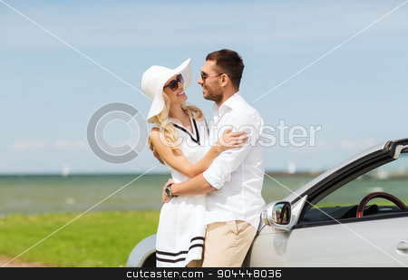 happy man and woman hugging near car at sea stock photo, transport, travel, love, date and people concept - happy man and woman hugging near cabriolet car at sea side by Syda Productions