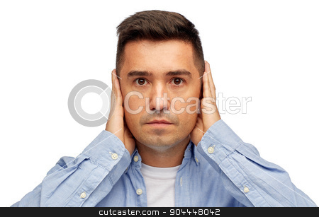 face of man covering his ears with hands stock photo, problem, emotion, stress, hearing problem and people concept - face of middle aged latin man covering his ears with hand palms by Syda Productions