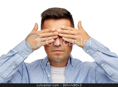 face of man covering his eyes with hands stock photo, problem, sight, vision, stress and people concept - face of middle aged latin man covering his eyes with hand palms by Syda Productions