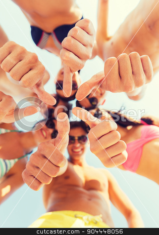 close up of friends showing thumbs in circle stock photo, friendship, summer vacation, holidays, gesture and people concept - close up of smiling friends wearing swimwear standing in circle and showing thumbs up over blue sky by Syda Productions