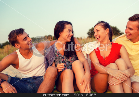 smiling friends in sunglasses on summer beach stock photo, friendship, summer vacation, holidays, gesture and people concept - group of smiling friends sitting on beach by Syda Productions