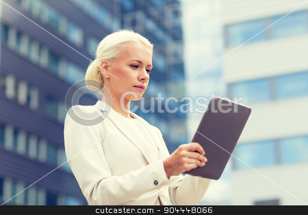 businesswoman working with tablet pc outdoors stock photo, business, education, technology and people concept - businesswoman working with tablet pc computer on city street by Syda Productions