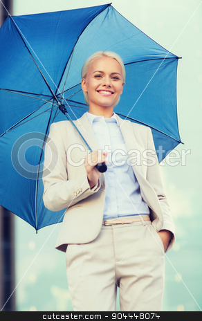 young smiling businesswoman with umbrella outdoors stock photo, business, bad weather and people and concept - young smiling businesswoman with umbrella outdoors by Syda Productions