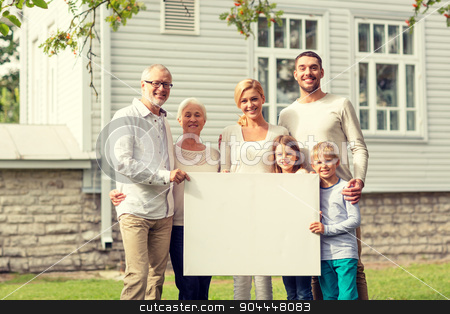 happy family in front of house outdoors stock photo, family, happiness, generation, home and people concept - happy family standing in front of house with white blank board outdoors by Syda Productions