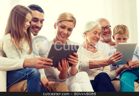 smiling family with tablet pc at home stock photo, family, generation, technology and people concept - smiling family with tablet pc computers at home by Syda Productions