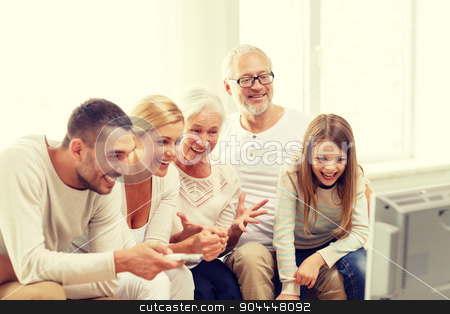 happy family watching tv at home stock photo, family, happiness, generation and people concept - happy family sitting on sofa and watching tv at home by Syda Productions