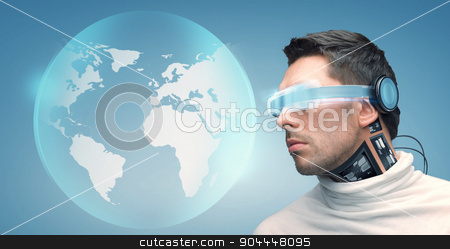 man with futuristic glasses and sensors stock photo, people, technology, future and progress - man with futuristic glasses and microchip implant or sensors over blue background and earth globe hologram by Syda Productions