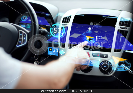 male hand using navigation system on car dashboard stock photo, transport, destination, modern technology and people concept - male hand searching for route using navigation system on car dashboard screen by Syda Productions