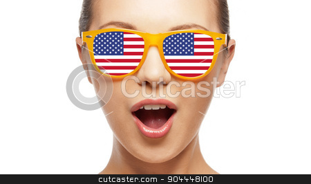 surprised girl in sunglasses with american flag stock photo, people, patriotism, national pride and independence day concept - happy teenage girl in sunglasses with american flag by Syda Productions