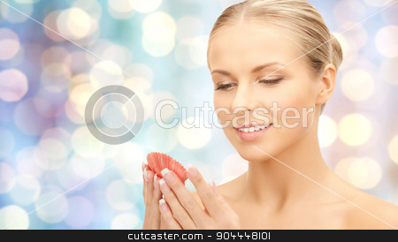 beautiful woman with seashell over blue lights stock photo, people, beauty and sea concept - beautiful woman with seashell over blue holidays lights background by Syda Productions