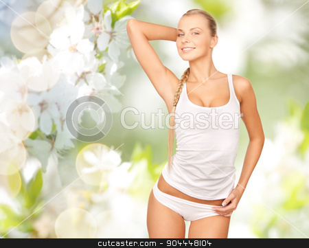 beautiful woman in underwear over cherry blossom stock photo, people, beauty, body care and health concept - happy beautiful young woman in cotton underwear posing over green cherry blossom background by Syda Productions