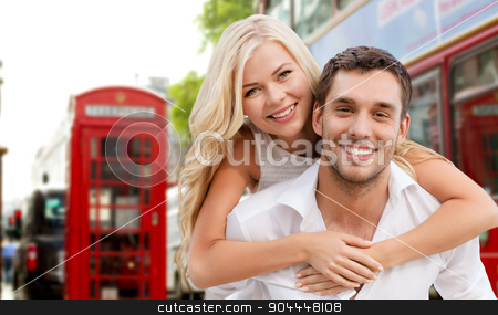 happy couple hugging over london city street stock photo, summer holidays, travel, tourism, people and dating concept - happy couple hugging over london city street background by Syda Productions