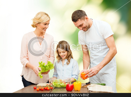 happy family cooking vegetable salad for dinner stock photo, vegetarian food, culinary, happiness and people concept - happy family cooking vegetable salad for dinner green natural background by Syda Productions