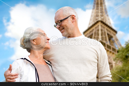 happy senior couple over paris eiffel tower stock photo, family, age, tourism, travel and people concept - happy senior couple over paris eiffel tower in france by Syda Productions
