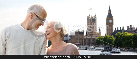 happy senior couple in london city stock photo, family, age, tourism, travel and people concept - happy senior couple over houses of parliament or palace of westminster and big ben clock tower in london by Syda Productions