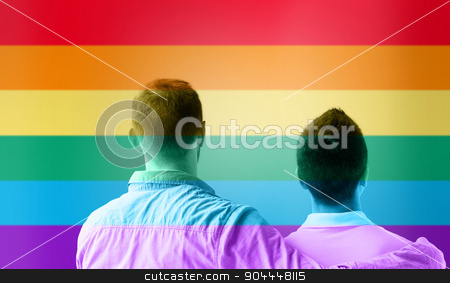 close up of male gay couple over rainbow flag stock photo, people, homosexuality, same-sex marriage, gay and love concept - close up of happy male gay couple or friends hugging from back over rainbow flag stripes background by Syda Productions