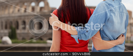close up of lesbian couple over coliseum in rome stock photo, people, homosexuality, same-sex marriage, travel and gay love concept - close up of happy lesbian couple hugging over coliseum in rome background by Syda Productions