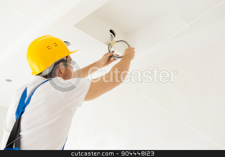 close up of builder or electrician running wires stock photo, repair, renovation, electricity and people concept - close up of builder or electrician running wires indoors by Syda Productions