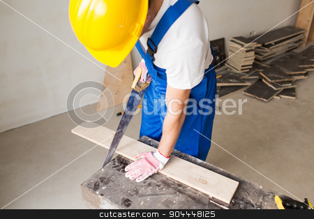 close up of builder with arm saw sawing board stock photo, building, carpentry, repair, teamwork and people concept - close up of builder with arm saw sawing board on table by Syda Productions