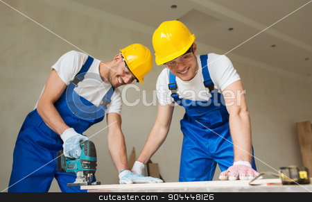 group of builders with tools indoors stock photo, business, building, teamwork and people concept - group of smiling builders in hardhats with tools indoors by Syda Productions