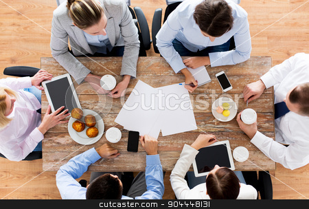 close up of business team drinking coffee on lunch stock photo, business, people, break and team work concept - close up of creative team meeting and drinking coffee with muffins during lunch in office by Syda Productions