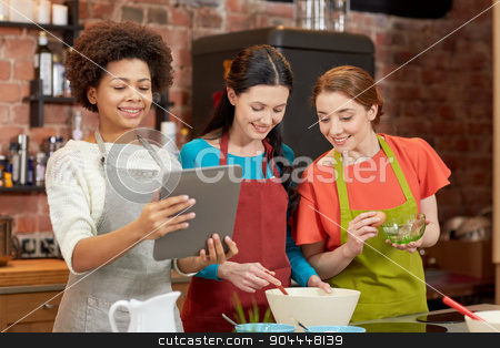 happy women with tablet pc cooking in kitchen stock photo, cooking class, friendship, food, technology and people concept - happy women with tablet pc computer in kitchen by Syda Productions