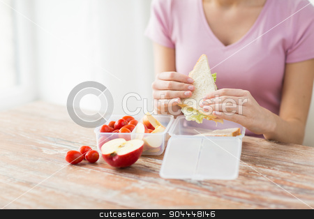 close up of woman with food in plastic container stock photo, healthy eating, storage, dieting and people concept - close up of woman with food in plastic container at home kitchen by Syda Productions