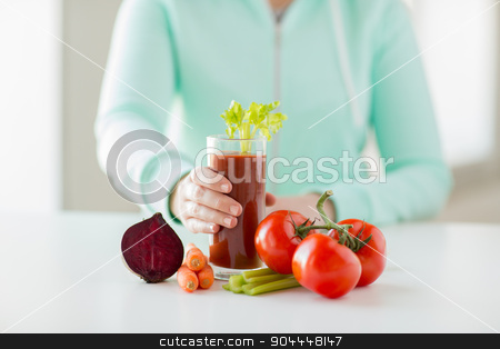 close up of woman hands with juice and vegetables stock photo, healthy eating, food, dieting and people concept - close up of woman hands with tomato juice and vegetables by Syda Productions