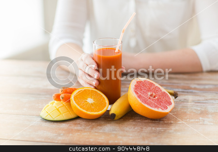 close up of woman hands with juice and fruits stock photo, healthy eating, food, dieting and people concept - close up of woman hands with fruits and fresh juice sitting at table by Syda Productions