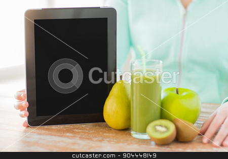 close up of woman hands tablet pc and fruit juice stock photo, healthy eating, technology, diet and people concept - close up of woman hands with tablet pc, fruits and fresh juice sitting at table by Syda Productions