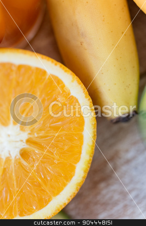 close up of fresh juicy orange and banana on table stock photo, healthy eating, food, fruits and diet concept - close up of fresh juicy cut orange and banana on table by Syda Productions