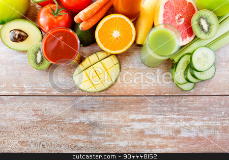 close up of fresh juice glass and fruits on table stock photo, detox, healthy eating, food and diet concept - close up of fresh juice glass and fruits on table by Syda Productions