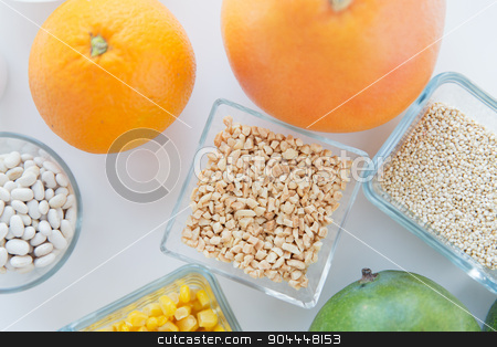 close up of food ingredients on table stock photo, healthy eating, breakfast, diet and culinary concept - close up of food ingredients on table by Syda Productions